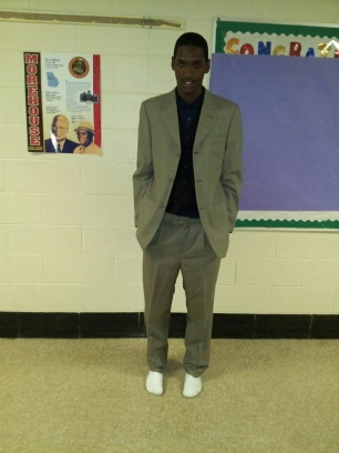 Daquan, of Randolph Highschool tries on this suit for size.